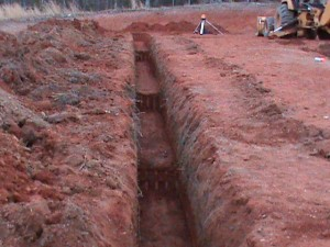 Foundation trench with 'steps' to compensate for land slope